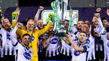 Lilywhite delight: Dundalk captain Brian Gartland lifts last season's Premier Division trophy – he and his team-mates will aim for more of the same when the season resumes after the enforced break. Photo: Sportsfile