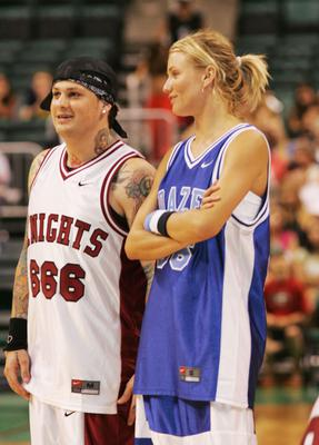 SUNRISE, FL - JULY 25:  Benji Madden of Good Charlotte and actress Cameron Diaz during the NSYNC Challenge For The Children Celebrity Basketball Game at Office Depot Center in Sunrise, Florida on July 25, 2004. (Photo by Alexander Tamargo/Getty Images)