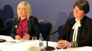 Northern Ireland Deputy Minister Michelle O'Neill (left) and Northern Ireland First Minister Arlene Foster speak to the media following a meeting in Co Armagh, for a special North-South meeting on Covid-19. Photo: Aine McMahon/PA Wire