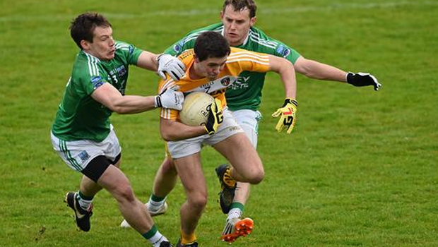 Niall Delargy, Antrim, is tackled by Tomás Corrigan, left, and Declan McCusker, Fermanagh. Ulster GAA Football Senior Championship, Quarter-Final, Fermanagh v Antrim, Brewster Park, Enniskillen, Co. Fermanagh. Picture credit: Ramsey Cardy / SPORTSFILE