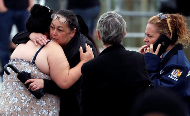 Relatives hug as they wait for rescue mission, following the White Island volcano eruption in Whakatane, New Zealand, December 13, 2019. REUTERS/Jorge Silva