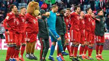 Bayern Munich players and mascot celebrate after a Bundesliga victory over VfL Wolfsburg last October. Photo: AFP/Getty Images
