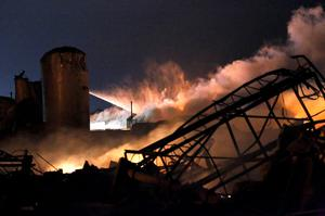 Smoke rises as water is sprayed at the burning remains of a fertilizer plant after an explosion at the plant in the town of West, near Waco.