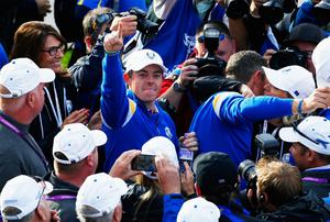 Rory McIlroy points the way with the first point of the day. Harry Engels/Getty Images