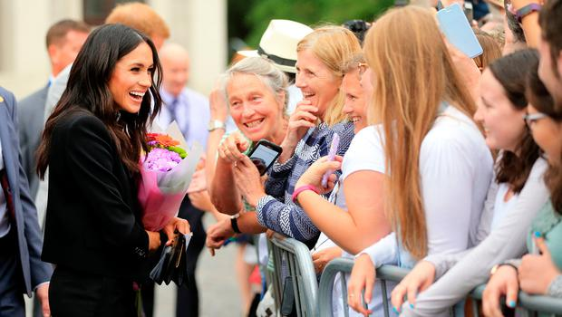 Jacqui O'Halloran (holding phone) meets Meghan Markle in the famous photograph taken by Gerry Mooney back in July.