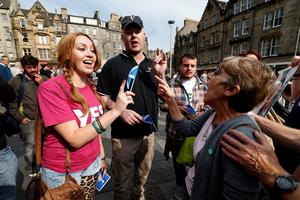 Rival campaigners shout the odds on an Edinburgh street