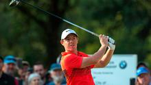 Rory McIlroy hits his first shot with new driver