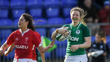 Lauren Delany scoring a try for Ireland against Wales in the Six Nations. Photo by Ramsey Cardy/Sportsfile