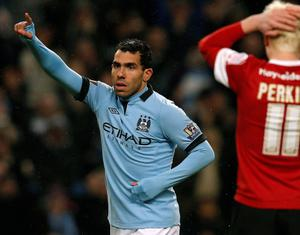 Carlos Tevez celebrates  scoring for Manchester City