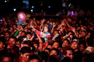 People celebrate the arrival of the new year during a 2014 new year's countdown party in Yangon. Photo: REUTERS/Soe Zeya Tun