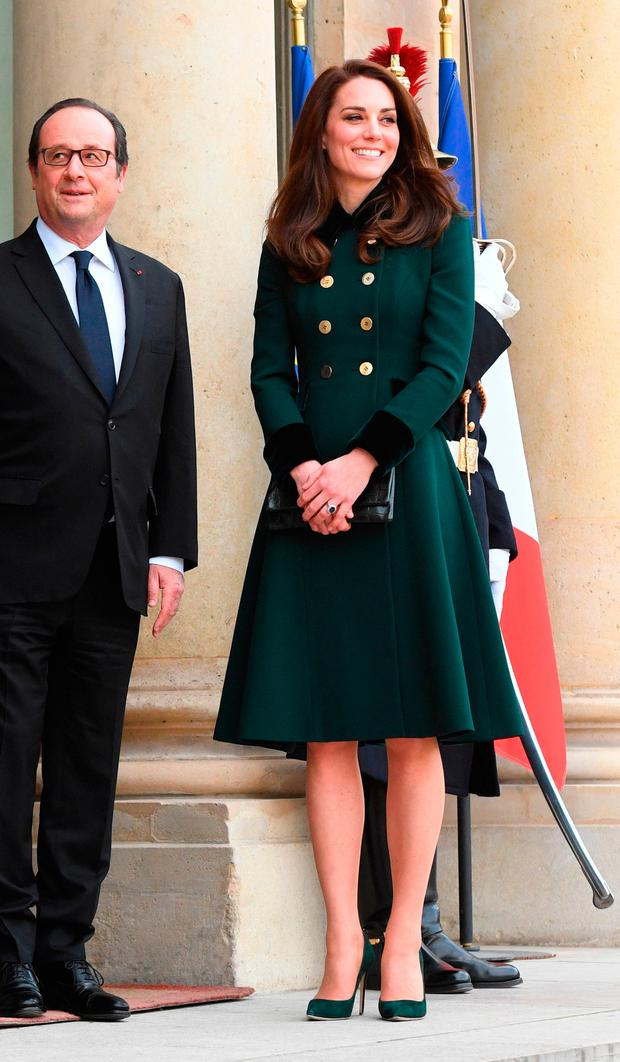 The Duchess of Cambridge is greeted by French President Francois Hollande at the Elysee Palace during an official visit to Paris, France.