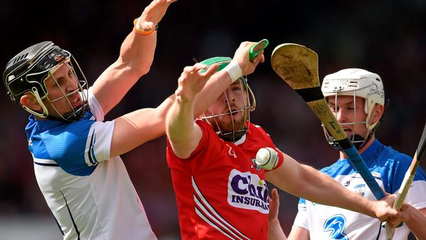 Cork's Cormac Murphy in action against Maurice Shanahan, left, and Brian O'Halloran