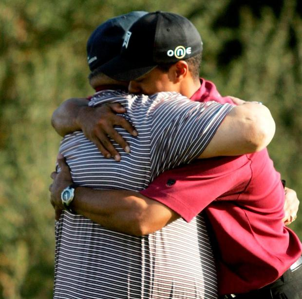 Tiger Woods hugs his father, Earl, after winning the Target World Golf Challenge in 2004. Photo: Doug Benc/Getty Images