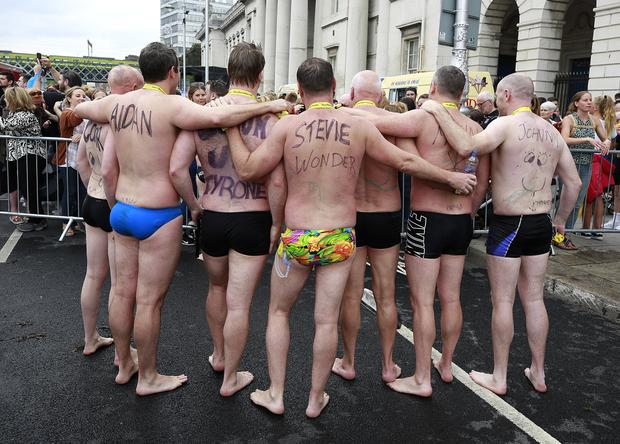 Swimmers pose for a picture after competing in the Liffey swim in Dublin. Picture credit; Damien Eagers / INM