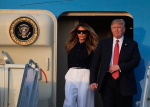 President Donald Trump and his wife Melania Trump arrive on Air Force One at the Palm Beach International airport as they prepare to spend part of the weekend with  Japanese Prime Minister Shinzo Abe and his wife Akie Abe at Mar-a-Lago resort on February 10, 2017 in West Palm Beach, Florida. The two are scheduled to get in a game of golf as well as discuss trade issues.  (Photo by Joe Raedle/Getty Images)