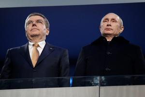Russian President Vladimir Putin, right, and International Olympic Committee President Thomas Bach attend the opening ceremony of the 2014 Winter Olympics in Sochi