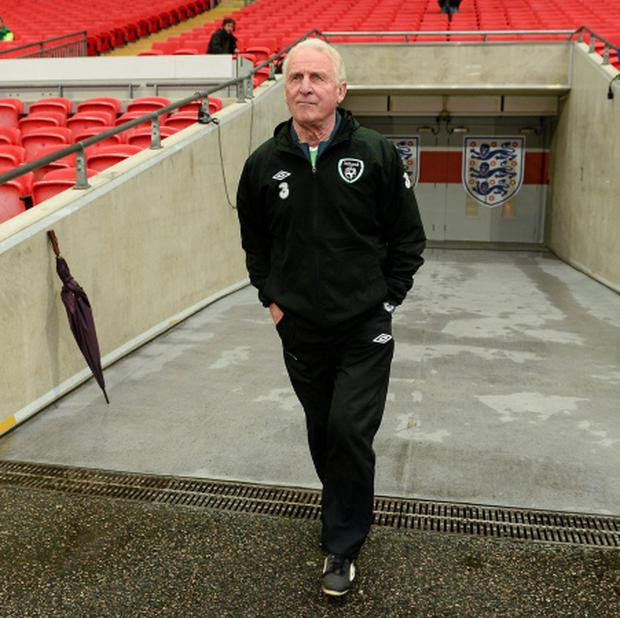 Republic of Ireland manager Giovanni Trapattoni makes his way out onto the Wembley pitch for the start of squad training. Photo: Sportsfile