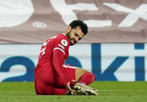 Liverpool's Mohamed Salah goes down in the area after a challenge by West Ham United's Arthur Masuaku resulting in a penalty
