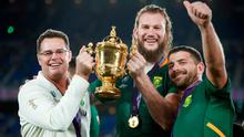 South Africa's head coach Rassie Erasmus (L) lifts the Webb Ellis Cup with South Africa's lock RG Snyman (C) and South Africa's full back Willie Le Roux as they celebrate winning the Japan 2019 Rugby World Cup final match between England and South Africa at the International Stadium Yokohama in Yokohama on November 2, 2019. (Photo by Odd ANDERSEN / AFP) (Photo by ODD ANDERSEN/AFP via Getty Images)