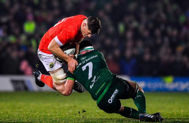 Jack O'Donoghue of Munster is tackled by Paul Boyle of Connacht during the Guinness PRO14 Round 8 match at The Sportsground in Galway. Photo: Brendan Moran/Sportsfile