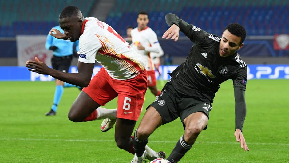 Manchester United's Mason Greenwood in action with RB Leipzig's Ibrahima Konate. Photo: Annegret Hilse/Pool via Reuters