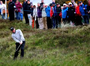 Miguel Angel Jimenez plays from the rough on the 18th during day one of the Dubai Duty Free Irish Open at Royal County Down Golf Club, Newcastle.  Brian Lawless/PA Wire