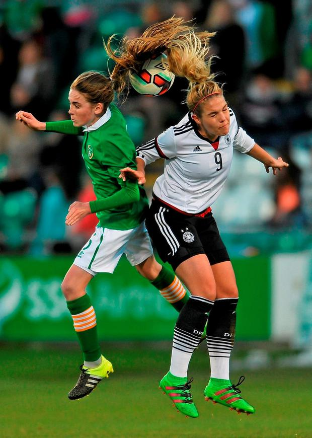 Ireland's Evelyn Daly jumps for the ball with Germany's Nina Ehegotz during last night's UEFA Women's U-19 Championship qualifier at Tallaght Stadium. Picture credit: Eóin Noonan / SPORTSFILE