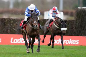 Bryony Frost riding Frodon (left) clear the last to win during King George VI Chase Day of the Ladbrokes Christmas Festival at Kempton Park Racecourse. Photo credit: Alan Crowhurst/PA Wire.