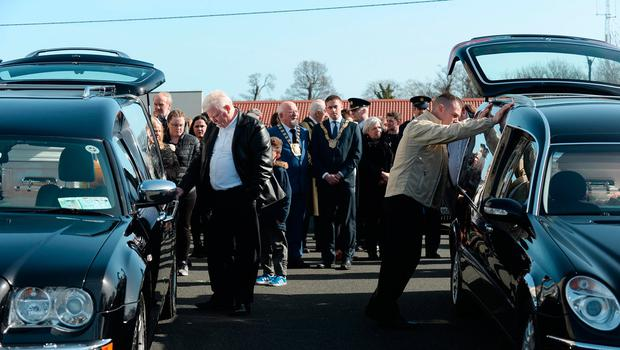 Father of Jordan and Holly Jamie Sommers, right, standing between their hearses after the funeral. Funeral of victims of Clondalkin fire. St. Anne's Church, Shankill, Dublin. Picture: Caroline Quinn