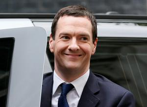 Britain's Chancellor of the Exchequer George Osborne smiles as he arrives back at Number 11 Downing Street after Britain's general election, in London May 8, 2015.  David Cameron's Conservatives are set to govern Britain for another five years after an unexpectedly strong showing, but may have to grapple with renewed calls for Scottish independence after nationalists surged. REUTERS/Stefan Wermuth