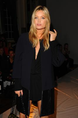 Here, she added a twist to her suit from earlier in the day - wearing a two tone coat and letting her hair down