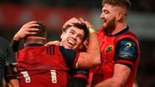 Alex Wootton of Munster celebrates with team-mates James Cronin, left, and Darren O'Shea after scoring his side's fifth try during the European Rugby Champions Cup Pool 4 Round 6 match between Munster and Castres at Thomond Park in Limerick. Photo by Diarmuid Greene/Sportsfile