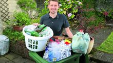 Pól Ó Conghaile with his recycling which he and his family collect in separate containers at their home in Greystones, Co Wicklow.  Photo: Frank McGrath