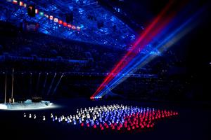 Athlete marshals light up to form a Russian flag during the Opening Ceremony of the Sochi 2014 Winter Olympics