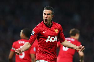 Robin van Persie celebrates scoring the opening goal against Aston Villa
