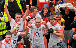 Cork players, from left, Ray Carey, Paudie Kissane, Paddy Kelly, Nicholas Murphy, Pearse O'Neill, Aidan Walsh and goalkeeper Alan Quirke with county secretary Frank Murphy, celebrate after the game in 2010