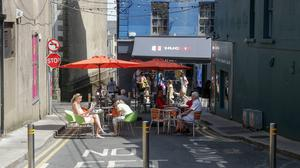 Customers enjoying outdoor dining at the bottom of Rowe Street.