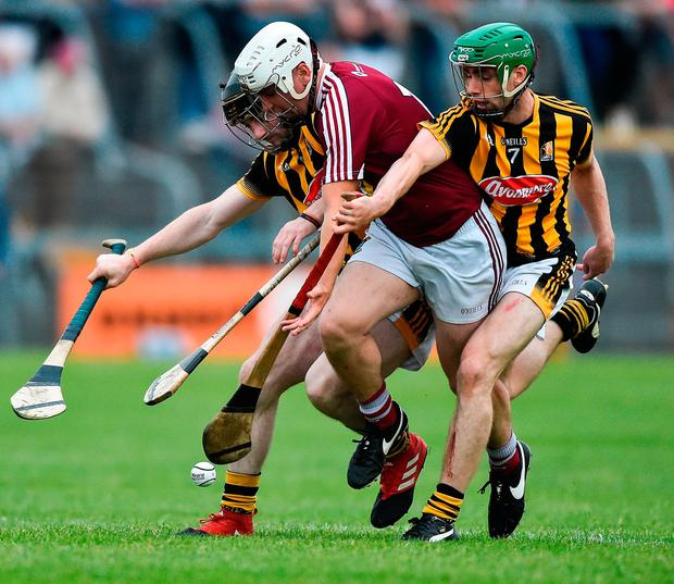 Killian Doyle of Westmeath in action against James Burke, left, and Tommy Walsh of Kilkenny. Photo by David Maher/Sportsfile