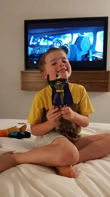 """""""This is my very happy son showing off a new batman figure he bought at Forbidden Planet in Dublin. We were on a father son staycation at the Hyatt Centric in Dublin... He is still talking about the trip and it reminded me that one-to-one time is so precious,"""" writes Keith Peters."""