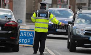 Gardai at a  checkpoint at the entrance to Phoenix Park in Dublin. Pic: Collins