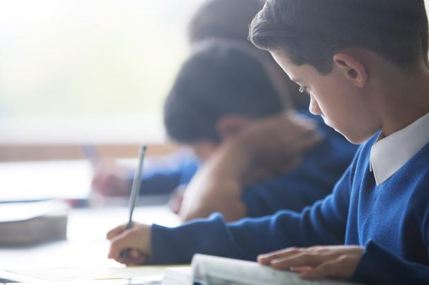 'Squeezed pupils in the two third classes at Our Lady Immaculate Senior National School, Darndale, Dublin, are paying a heavy price for Department of Education rules.' Stock photo: Getty Images