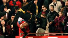 Man Utd' s Eric Cantona jumps into the crowd with his infamous Kung- Fu kick on a Palace supporter after being sent- off