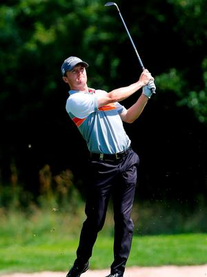 Michael Hoey plays a shot during the BMW International Open at the Eichenried Golf Club in Munich yesterday