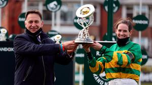 Henry De Bromhead and Rachael Blackmore receive the Randox Grand National Handicap Chase trophy after winning with Minella Times. (Photo by David Davies - Pool/Getty Images)