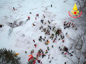 This aerial view taken from a drone shows rescuers working amidst snow and debris. Photo: Italian Firefighters/ANSA via AP