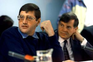 Apartheid death-squad leader Eugene de Kock (L) appears before the Truth And Reconciliation Commission (TRC) amnesty hearing with his lawyer Schalk Hugo in Pretoria in this May 24, 1999 file photo. REUTERS/Juda Ngwenya/Files