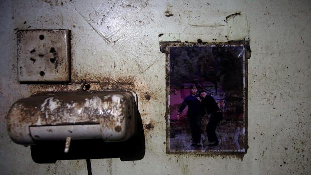 A picture is seen on the wall of a crew member dormitory inside the Eastern Star cruise ship, which capsized on the Jianli section of the Yangtze River, Hubei province, June 7, 2015. REUTERS/China Daily