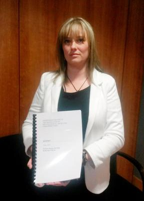 Mairia Cahill holding a report by Sir Keir Starmer who carried out an independent review into how allegations against an alleged IRA member of abusing Ms Cahill and two other women as children, were dealt with by the prosecution at the Public Prosecution Service offices in Belfast (David Young/PA Wire)