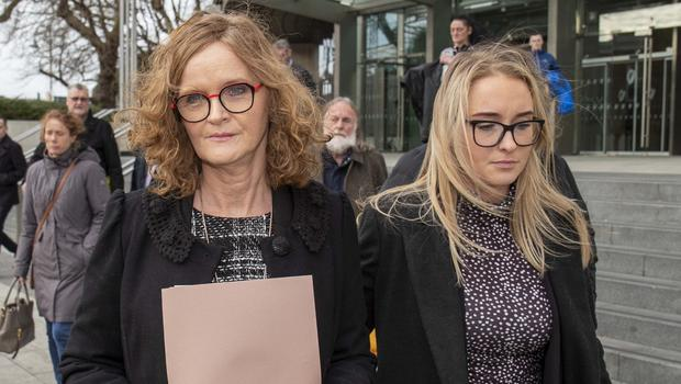 Mary Mullally (left), Patrick's sister, leaves court with other family members