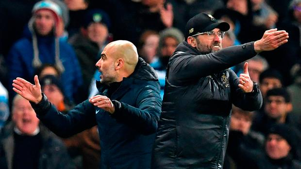 Liverpool's German manager Jurgen Klopp (R) and Manchester City's Spanish manager Pep Guardiola (L) gesture on the touchline during the English Premier League football match between Manchester City and Liverpool at the Etihad Stadium in Manchester, north west England, on January 3, 2019. - Manchester City won the game 2-1. (Photo by Paul ELLIS / AFP)
